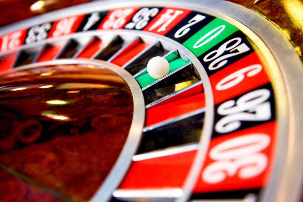 casino roulette close up with the ball on number zero-3